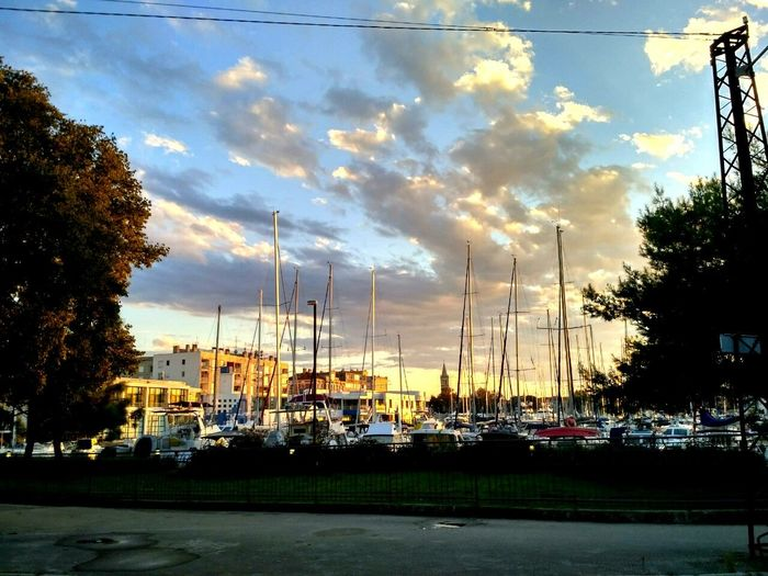 Transportation Mode Of Transport Nautical Vessel Moored Harbor Mast Tree Road Street Sky Cloud - Sky Cloud Waterfront Water Sailboat Town Day Sea Calm Outdoors