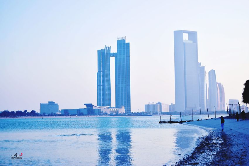 Abu Dhabi Skyscraper Architecture Building Exterior City Cityscape Built Structure Urban Skyline Water Day Clear Sky Beach Outdoors Sky Modern