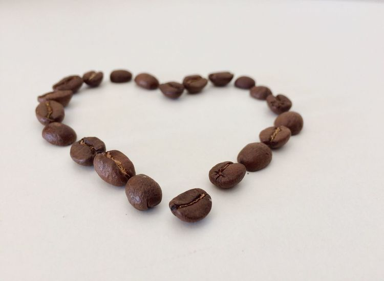 Coffee Love EyeEm Selects Roasted Coffee Bean Still Life Raw Coffee Bean Food And Drink Coffee Bean White Background Close-up Brown Food Freshness Food Stories