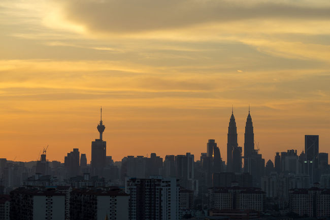 sunset in downtown kuala lumpur Architecture Building Exterior Business Finance And Industry City City Life Cityscape Day Downtown District Horizontal KL TOWER KLCC Park KLCC Tower KLCC Twin Towers Kuala Lumpur City Center Kuala Lumpur Malaysia  Modern No People Outdoors Petronas Twin Towers Sky Skyscraper Sunset Tower Travel Destinations Urban Skyline