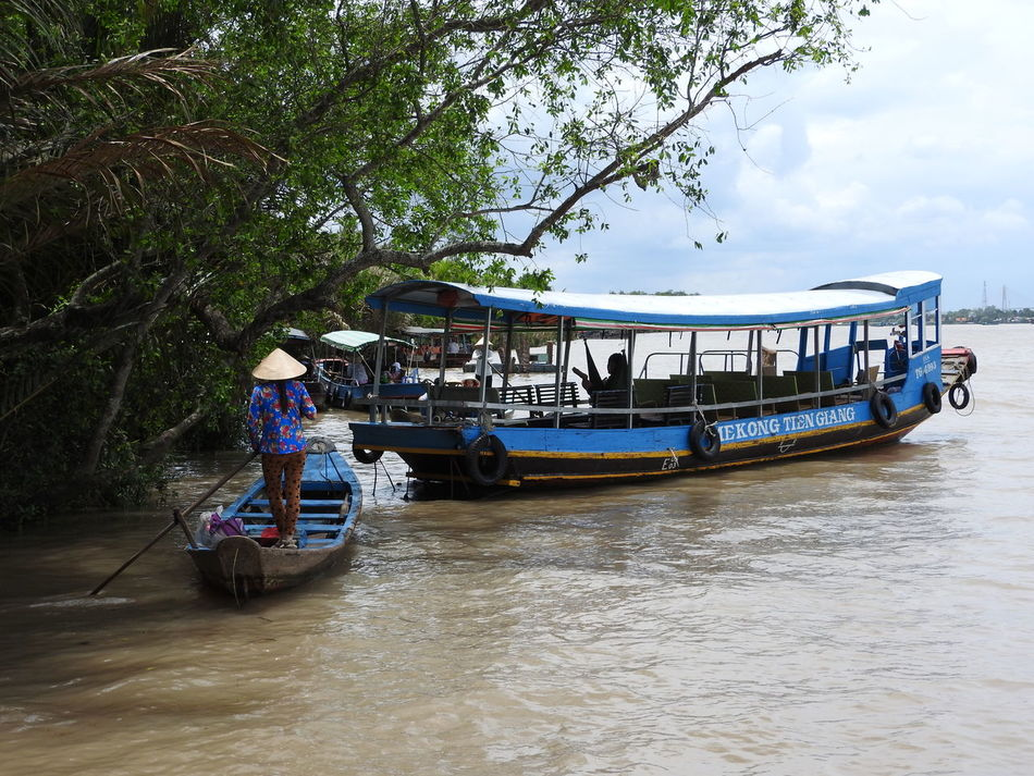 Empress Of The River ~ Boat Hat Houseboat Leaf Hat Long Boat Mekong Delta Mode Of Transport Moored Nautical Vessel Non La Oar One Person Outdoors People Pontoon Real People River Sky Standing Transportation Tree Vietnam Water Waterfront Young Adult