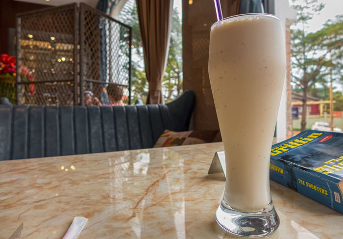 banana milkshake in a restaurant Milkshake Close-up Day Drink Drinking Glass Focus On Foreground Food And Drink Freshness Indoors  No People Table