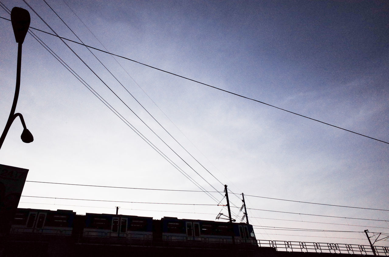 cable, power line, low angle view, power supply, sky, connection, electricity, no people, electricity pylon, transportation, day, outdoors, fuel and power generation, nature, technology, telephone line