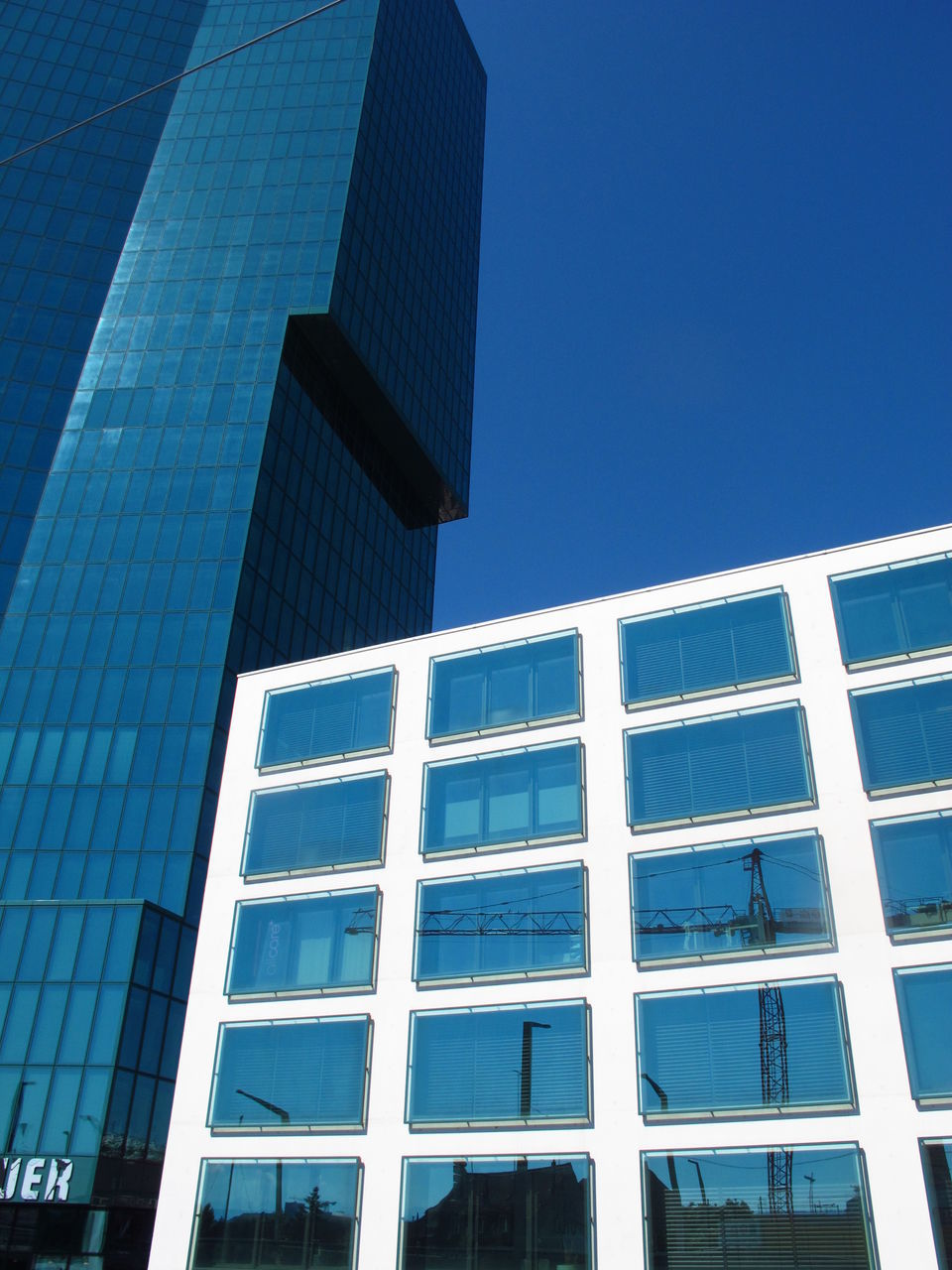 architecture, building exterior, built structure, modern, blue, low angle view, window, day, no people, outdoors, clear sky, skyscraper, city