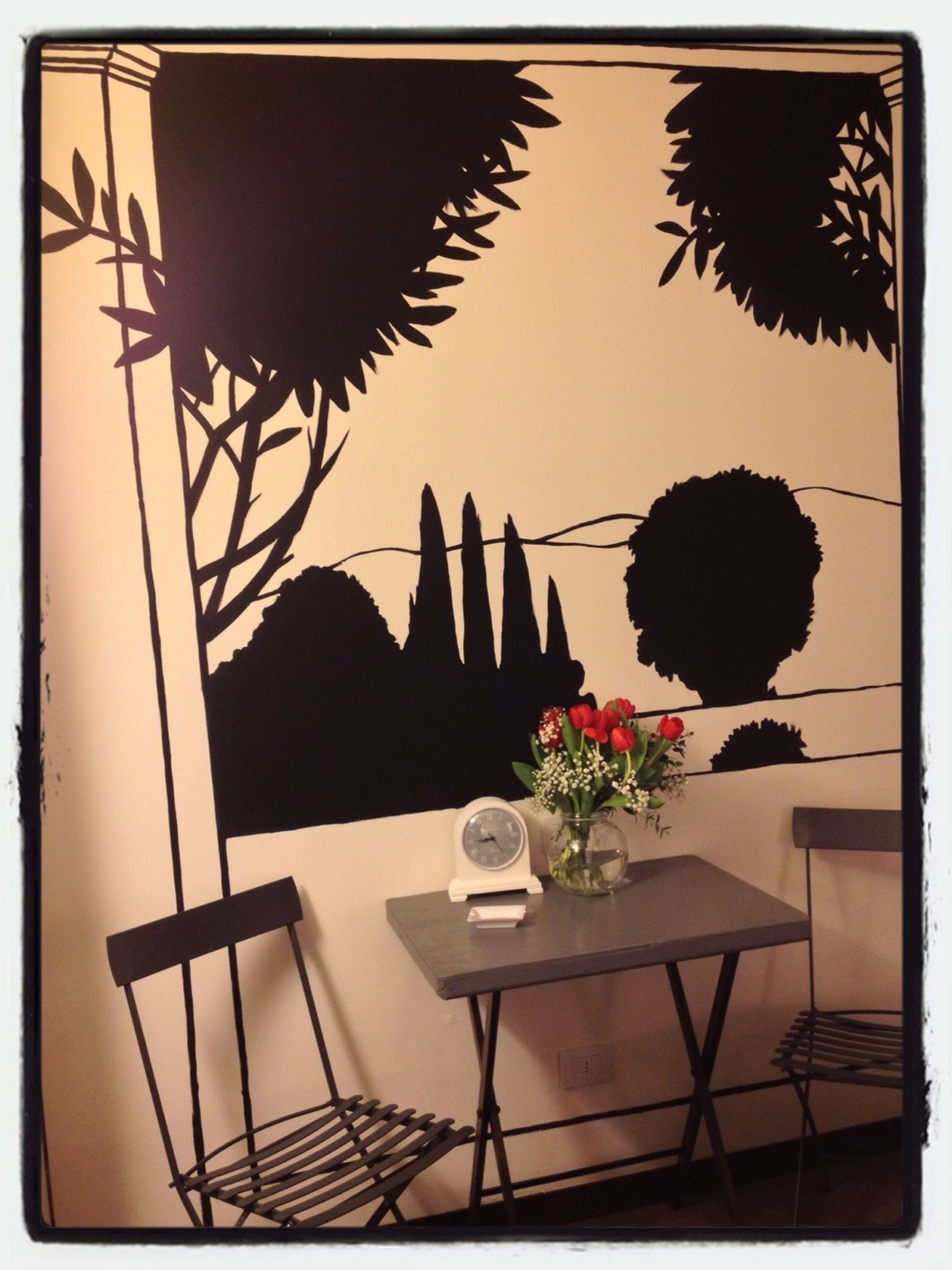 table, transfer print, indoors, flower, potted plant, chair, auto post production filter, vase, plant, growth, restaurant, absence, freshness, home interior, no people, empty, flower pot, nature, sunlight, decoration