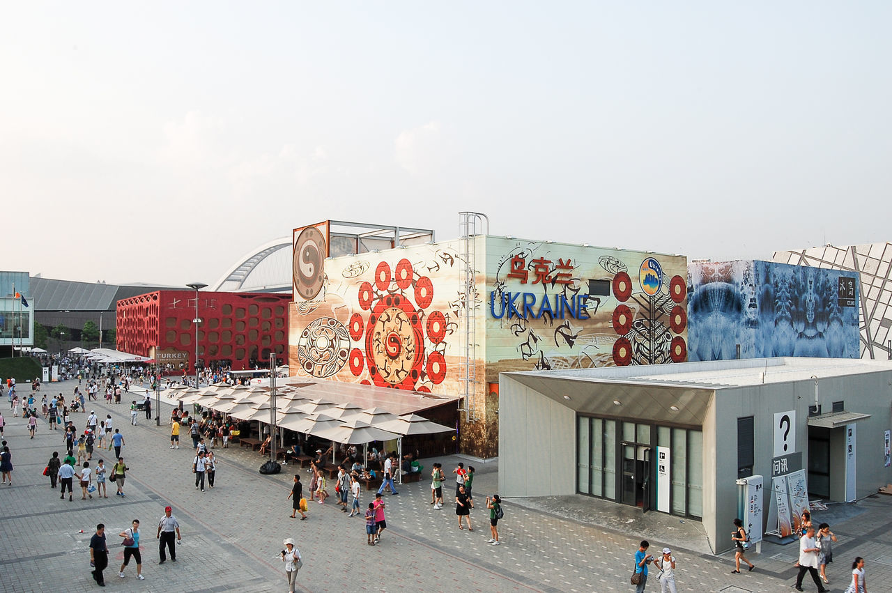 Architecture ASIA Building Exterior China Chinese City City Life Cultural Discovery Event Expo 2010 Image Incidental People International Leisure Activity Megalopolis Modern Recreational Pursuit Shanghai Smog Tourism Tourist Attraction  Travel Urban Ukrainian Pavilion