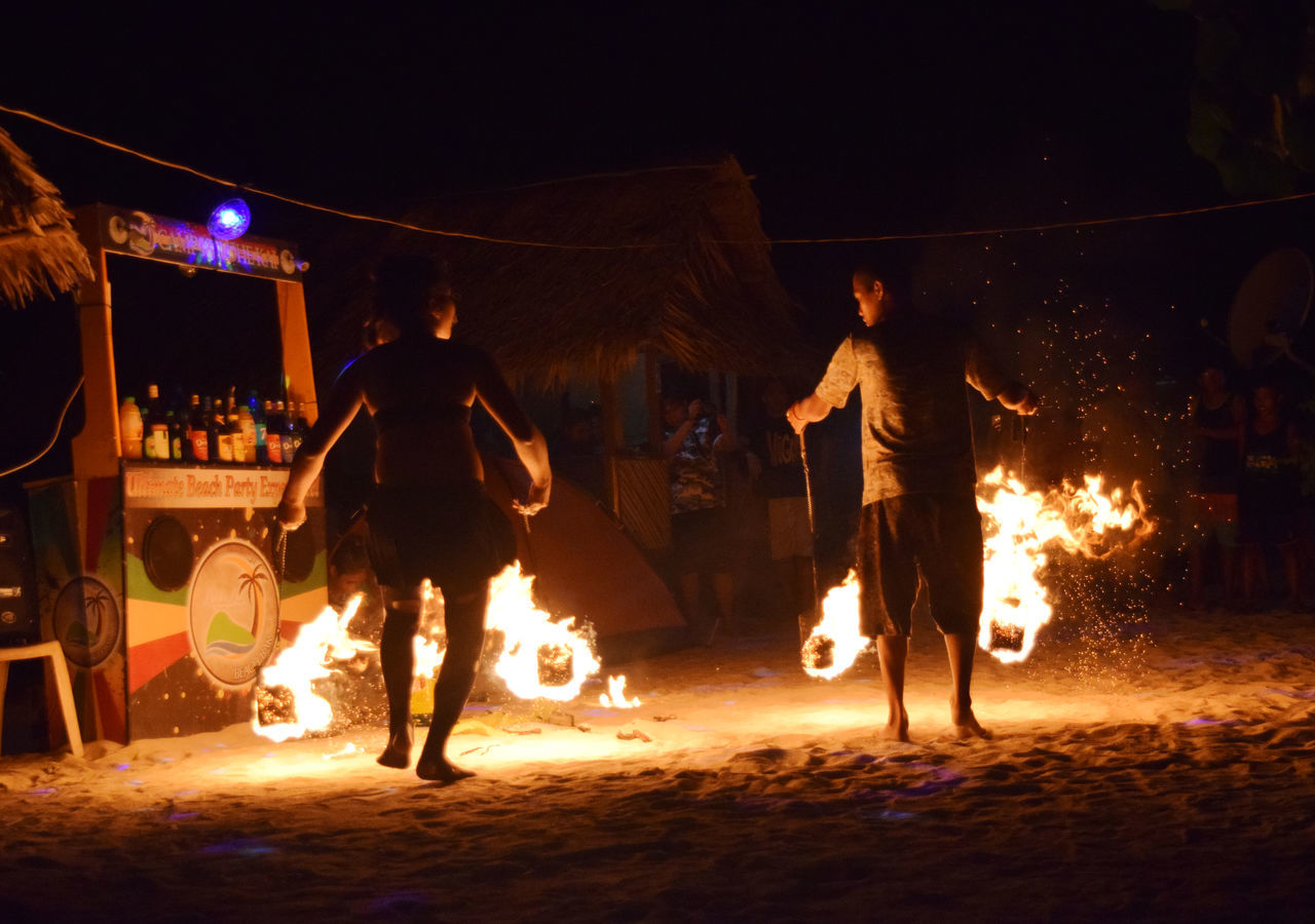 Adult Dancing Enjoyment Fire Dance Fire Dancer Flame Fun Illuminated Leisure Activity Lifestyles Motion Night Nightlife Outdoors Party - Social Event Calaguas Island Philippines People Calaguas Island Performance Real People Young Adult EyeEmNewHere The Great Outdoors - 2017 EyeEm Awards