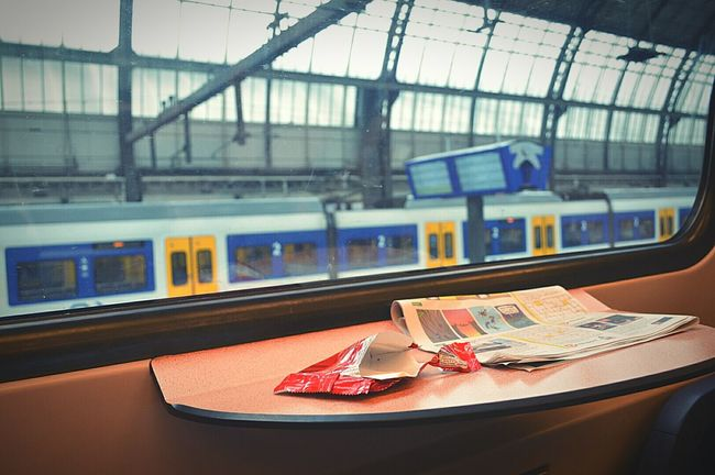 Waiting To Depart at Amsterdam Central Station Central Station Amsterdam Amsterdam City Amsterdam Trip Amsterdam Trainstation Train Amsterdam Life Train Ride Waiting To Leave Waiting Train Window Trains Train Station On The Train Travelling By Train Table Litter Sweet Package Newspaper Discarded Stuff Taking A Break Nikon D3200
