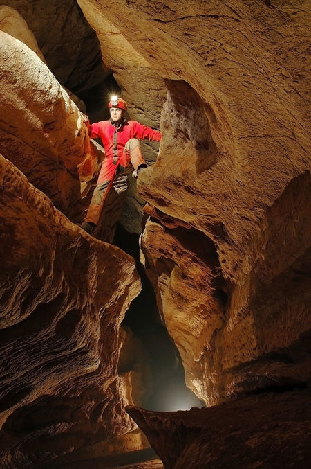 Spelunker exploring a cave Archeology Catacomb Cave Cavern Caves Caves Photography Dark Discovery Explorer Exploring Geological Formation Geology Grotto Helmet Light Mountain Nature Realm Speleo Speleology Spelunkers Spelunking Sport Spéléologie Underground