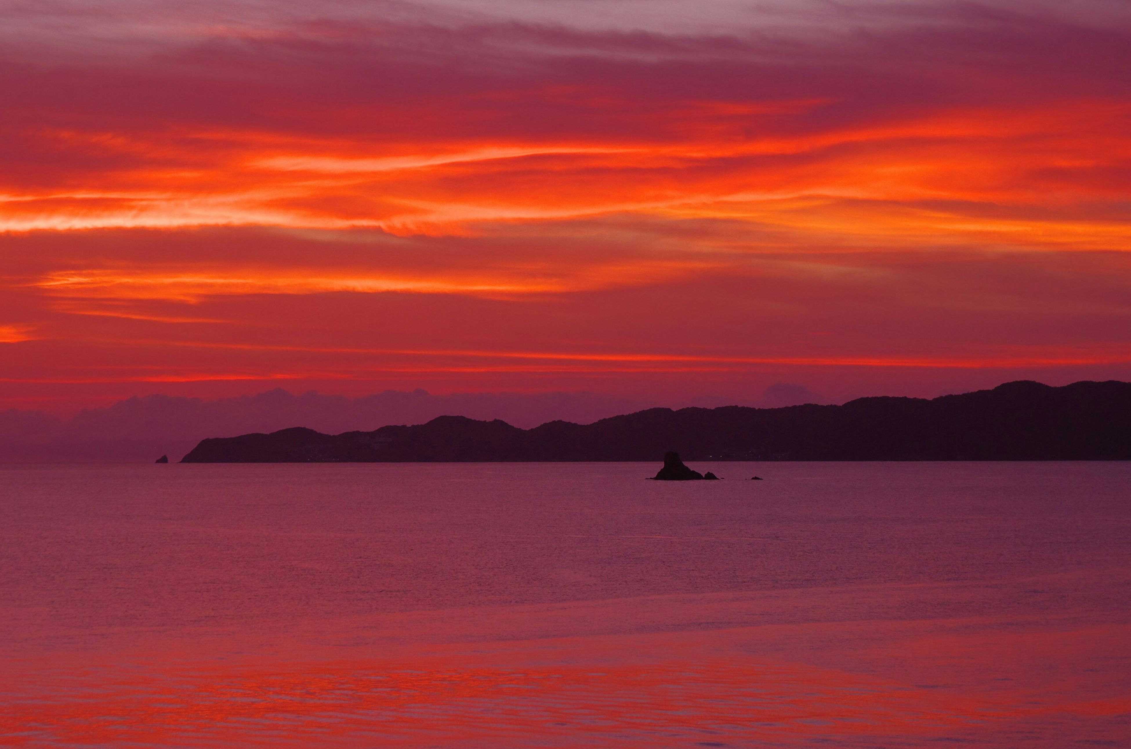 sunset, water, orange color, scenics, sky, tranquil scene, tranquility, beauty in nature, silhouette, sea, waterfront, nautical vessel, idyllic, boat, cloud - sky, transportation, nature, mountain, rippled, cloud