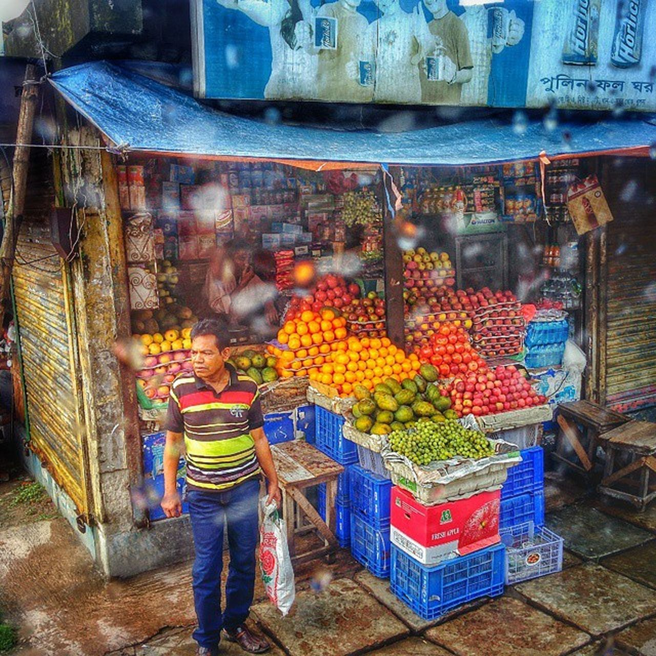 fruit, market, food, business, variation, retail, people, adult, outdoors, healthy eating, multi colored, freshness, occupation, day, adults only, city, one person, supermarket