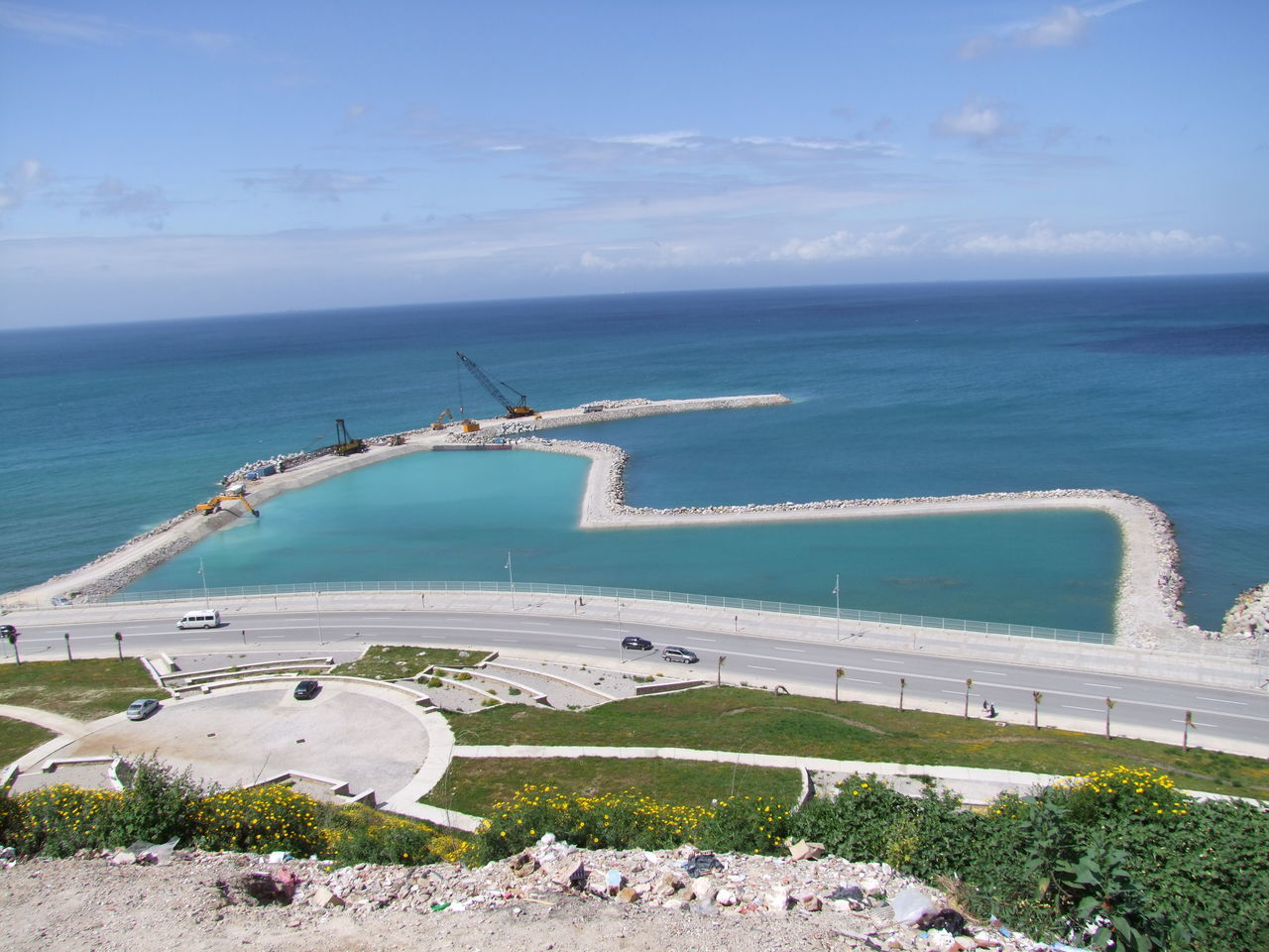 New Dock being built, viewed from the Kasbah Blue Sea Blue Sky White Clouds Coastline Composition Construction Construction Site Construction Work Cranes Dock Grass Horizon Over Water Morocco No People Outdoor Photography Ripples In The Water Road Sand Sea Sunlight Tangier Water