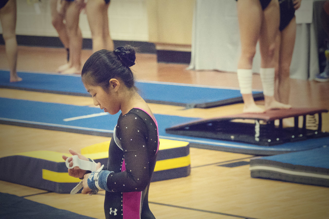 Ready to Compete Competing Competition Day Competitive Sport Girl Grips GymLife Gymnast  Gymnastics Meet Indoors  Lifestyles One Person Real People