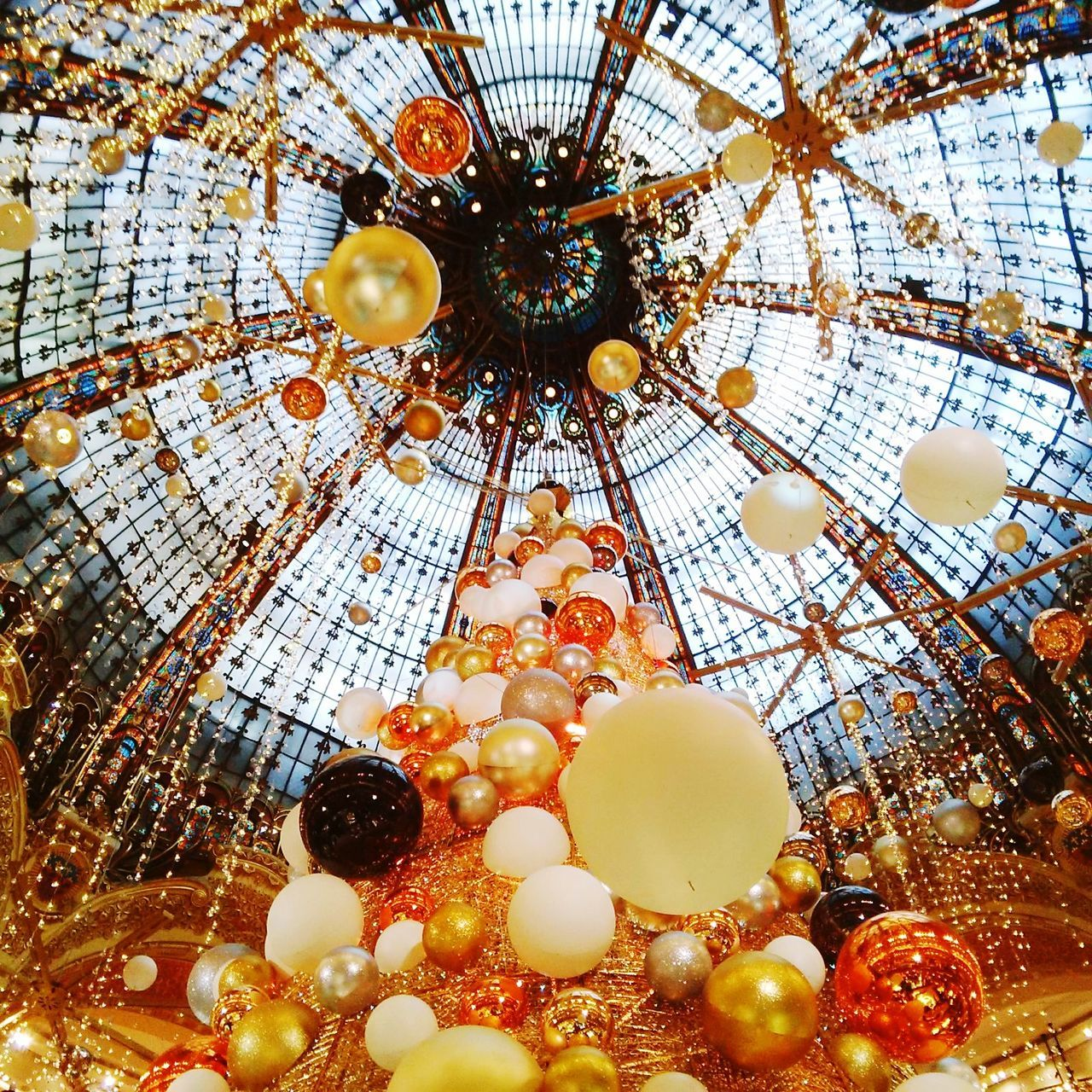 Christmas Lights Christmas Decoration Christmastime Christmas Around The World Christmas Tree Ceiling Indoors  Hanging No People Day Paris Christmas In Paris Christmas Decorations Low Angle View Close-up Holiday - Event Event Multi Colored Travel European City Love Christmas