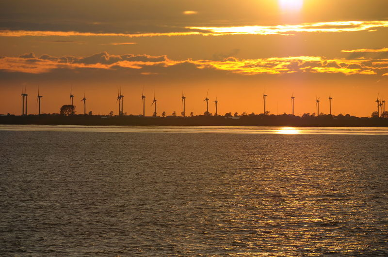 Windpark Cityscape Clean Energy Dusk Elbe Windpark Night No People Outdoors Sea Sky Sunset Sunset At The Elbe River Travel Destinations Urban Skyline Water