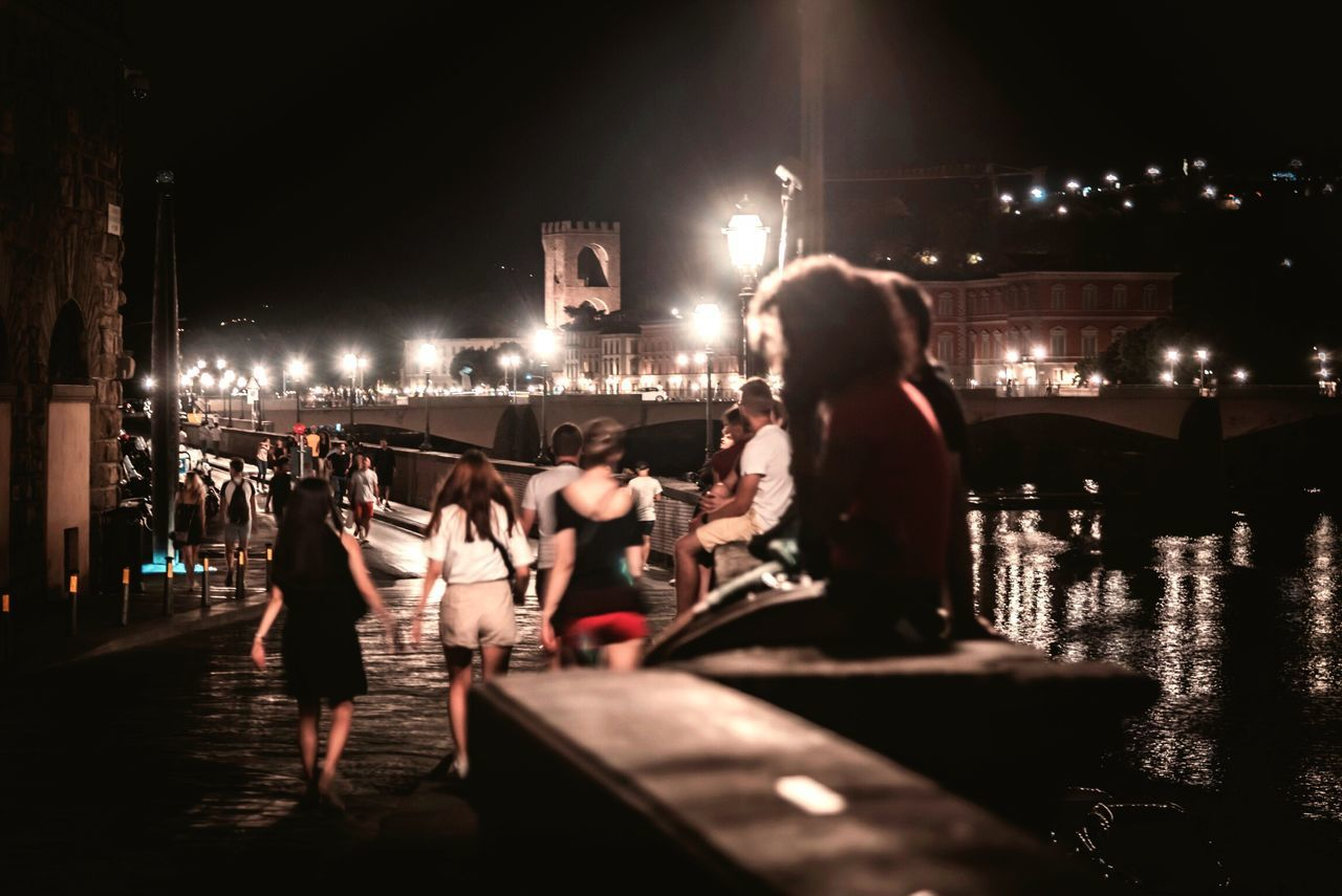 real people, night, illuminated, lifestyles, built structure, men, architecture, outdoors, leisure activity, large group of people, water, building exterior, women, city, nautical vessel, sky, people
