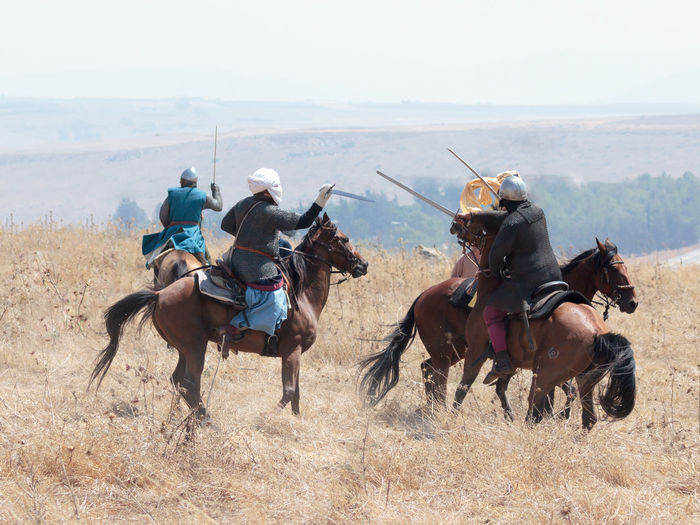 Tiberias, Israel, July 01, 2017 : Participants in the reconstruction of Horns of Hattin battle in 1187 participate in the battle on horseback on the battlefield near TIberias, Israel Army Battle Cross Crusaders Field Guy De Lusignan Hattin Heat Heritage History Horn Horseman Infantry Israel Jerusalem KINGDOM Muslims Palestine Reconstruction Religion Saladin Templars Victory War Weapons