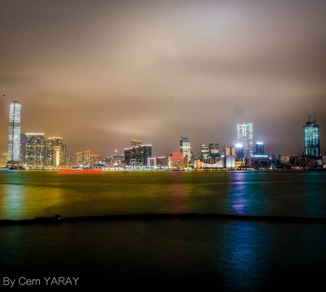 architecture, building exterior, skyscraper, city, built structure, cityscape, urban skyline, waterfront, illuminated, travel destinations, river, water, modern, sky, skyline, tower, no people, downtown district, night, city life, financial district, tall, growth, outdoors, nature