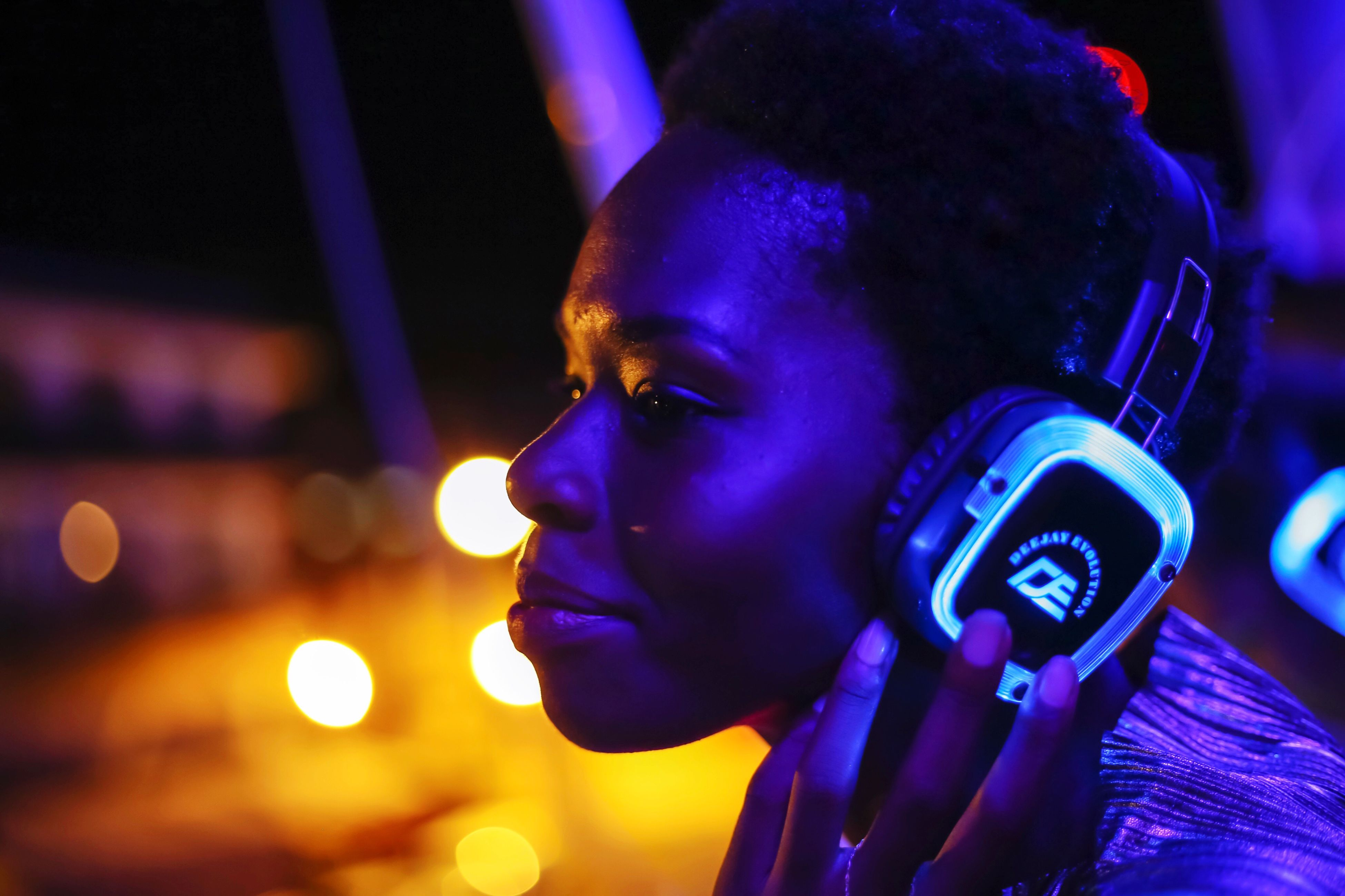 headshot, illuminated, focus on foreground, one person, lifestyles, close-up, neon, real people, young adult, night, indoors, young women, people, adult