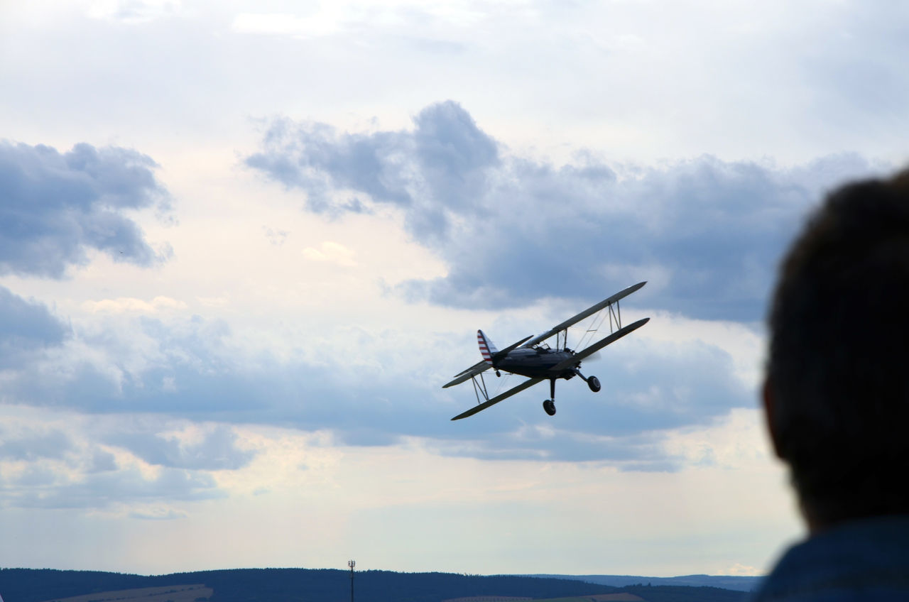 Acrobatic Flight Adult Aerospace Industry Air Force Air Vehicle Airplane Airport Back View Cloud - Sky Day Flying Focus On Background Goodbye Journey Observing One Man Only One Person Outdoors People Pilot Plane Rear View Sky Technology Watching