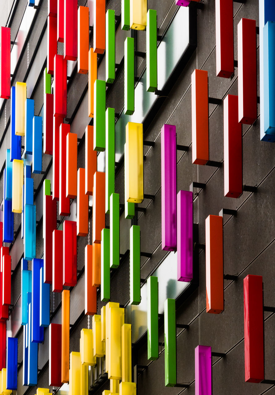 multi colored, variation, colorful, large group of objects, paper, shelf, no people, architecture, indoors, day, close-up
