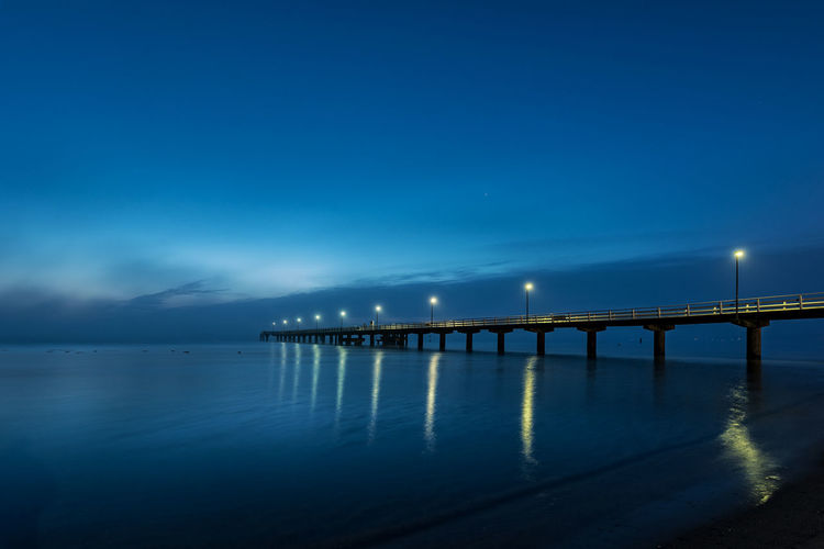 Seabridge Baltic Sea Lanterns Night Lights Architecture Beach Beauty In Nature Before Sunrise Blue Bridge - Man Made Structure Built Structure Connection Horizon Over Water Illuminated Nature Night Night Blue No People Outdoors Scenics Sea Seabridge By Night Sky Water