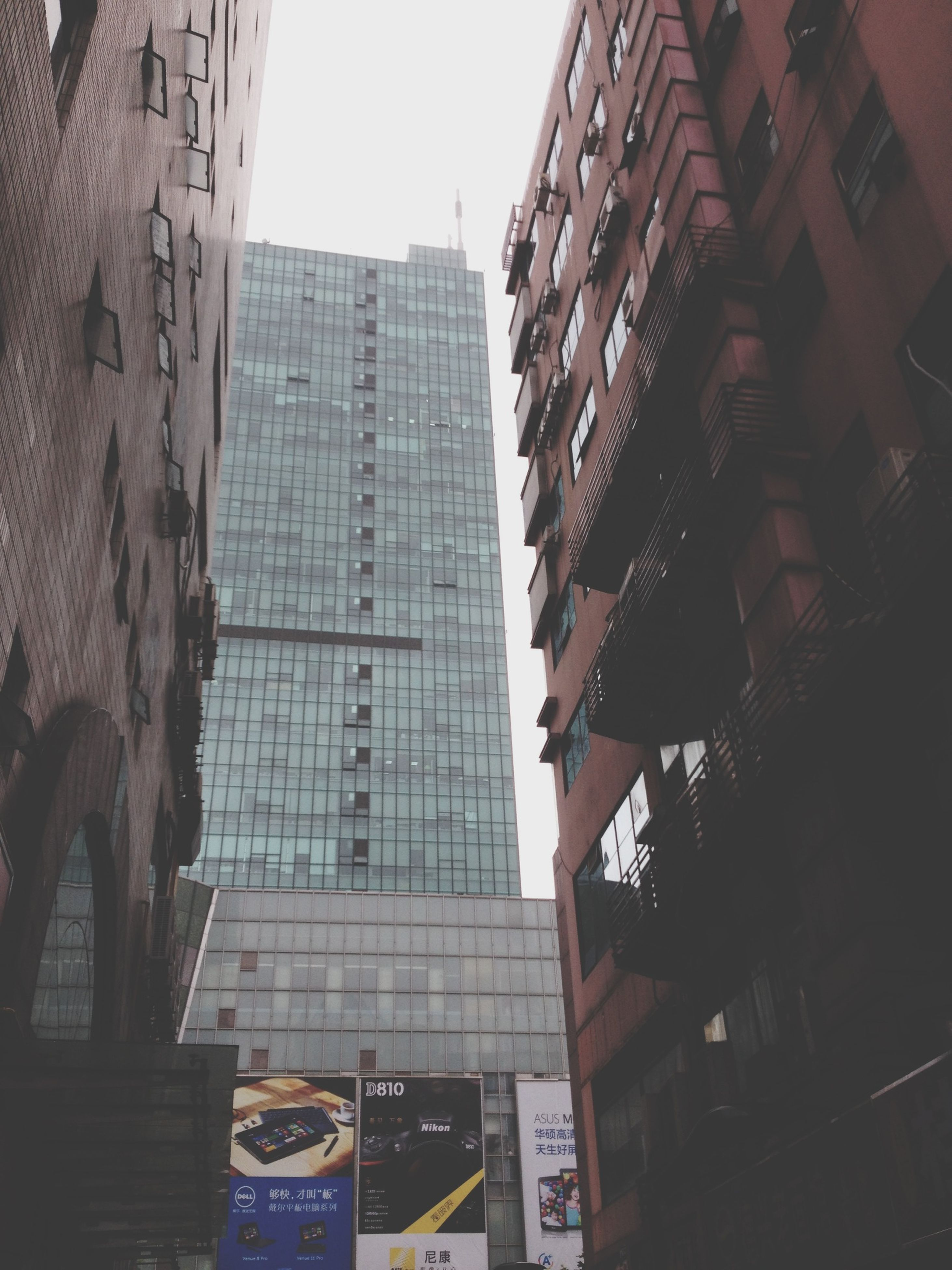 building exterior, architecture, built structure, city, low angle view, building, skyscraper, office building, tall - high, modern, tower, residential building, city life, window, residential structure, clear sky, day, outdoors, sky, no people