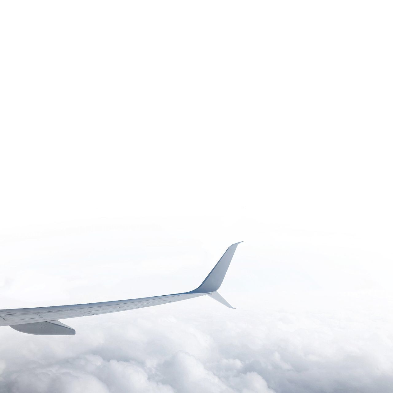 Airplane Wing Over Sea Of Clouds