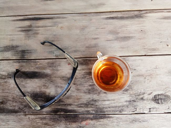 when you feel relax .. Drink High Angle View Tea - Hot Drink Table Drinking Glass Wood - Material Freshness Day Close-up Indoors  Refreshment Tea Tea Time Cup Of Tea Spectacle Wood Grain No People