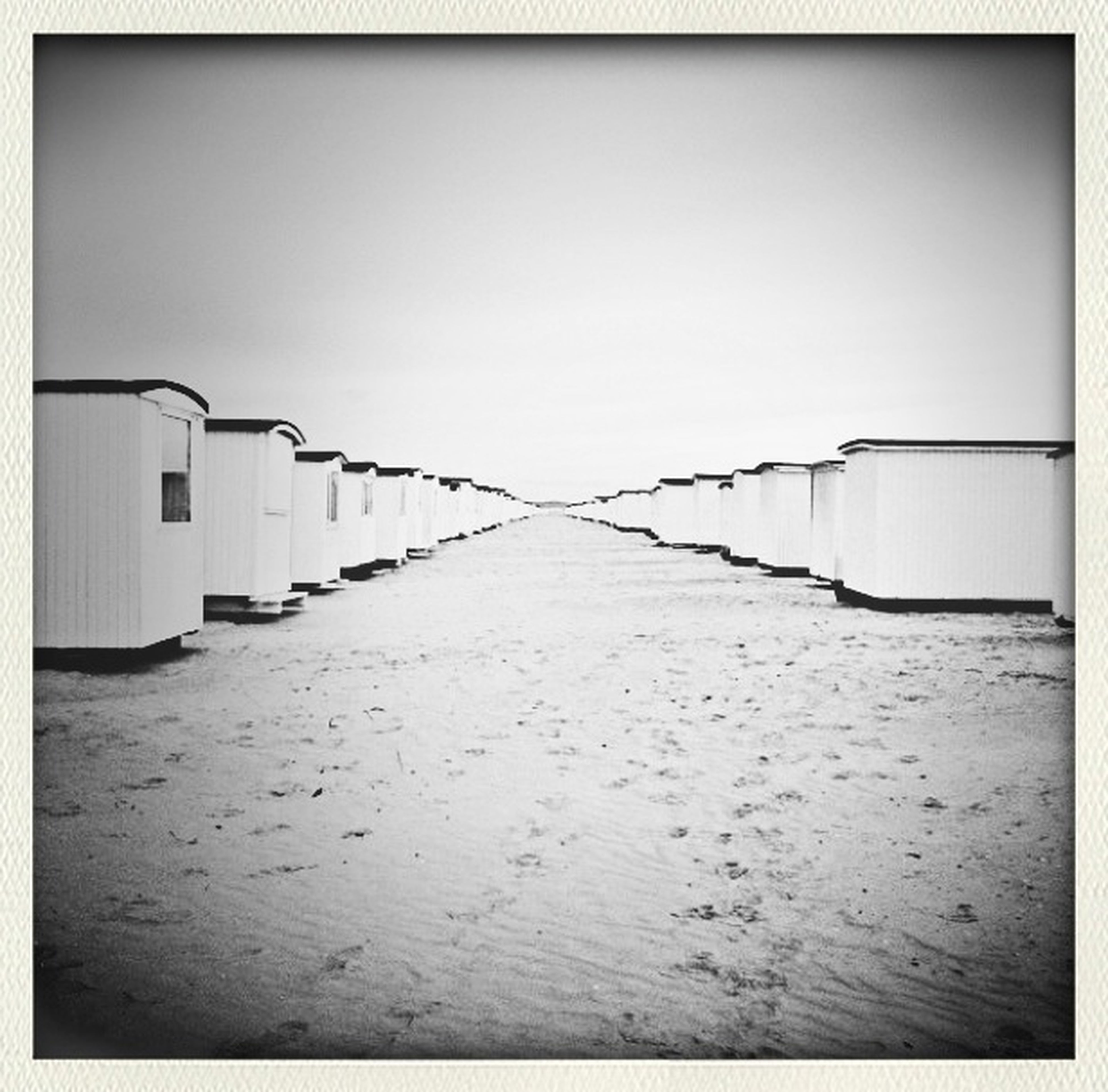 transfer print, auto post production filter, built structure, architecture, clear sky, copy space, the way forward, building exterior, empty, diminishing perspective, absence, day, vignette, no people, in a row, wall - building feature, outdoors, wall, house, sand