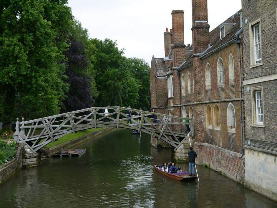 Crossing one of the most iconic landmarks- The Mathematical Bridge in Cambridge Ancient Architecture Taking Photos River Cam Travel Photography Holiday And Relaxing