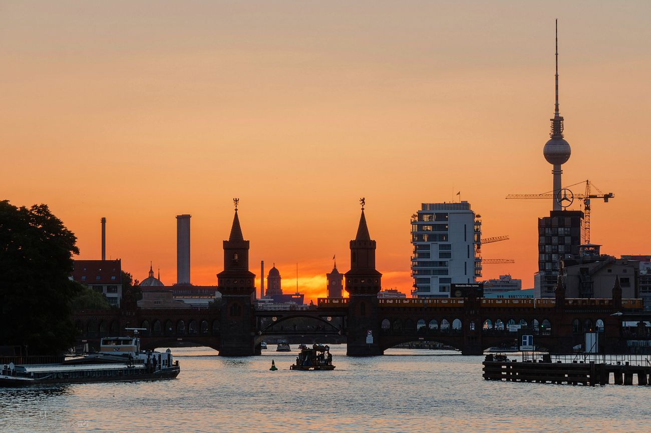 Towers, Cranes, Boats, and a Subway Berlin My Fuckin Berlin Berliner Ansichten Spree Harbor Treptow Skyline No People Clouds And Sky Sunset City Enjoying The View Enjoying The Sunset Silhouette Cityscape