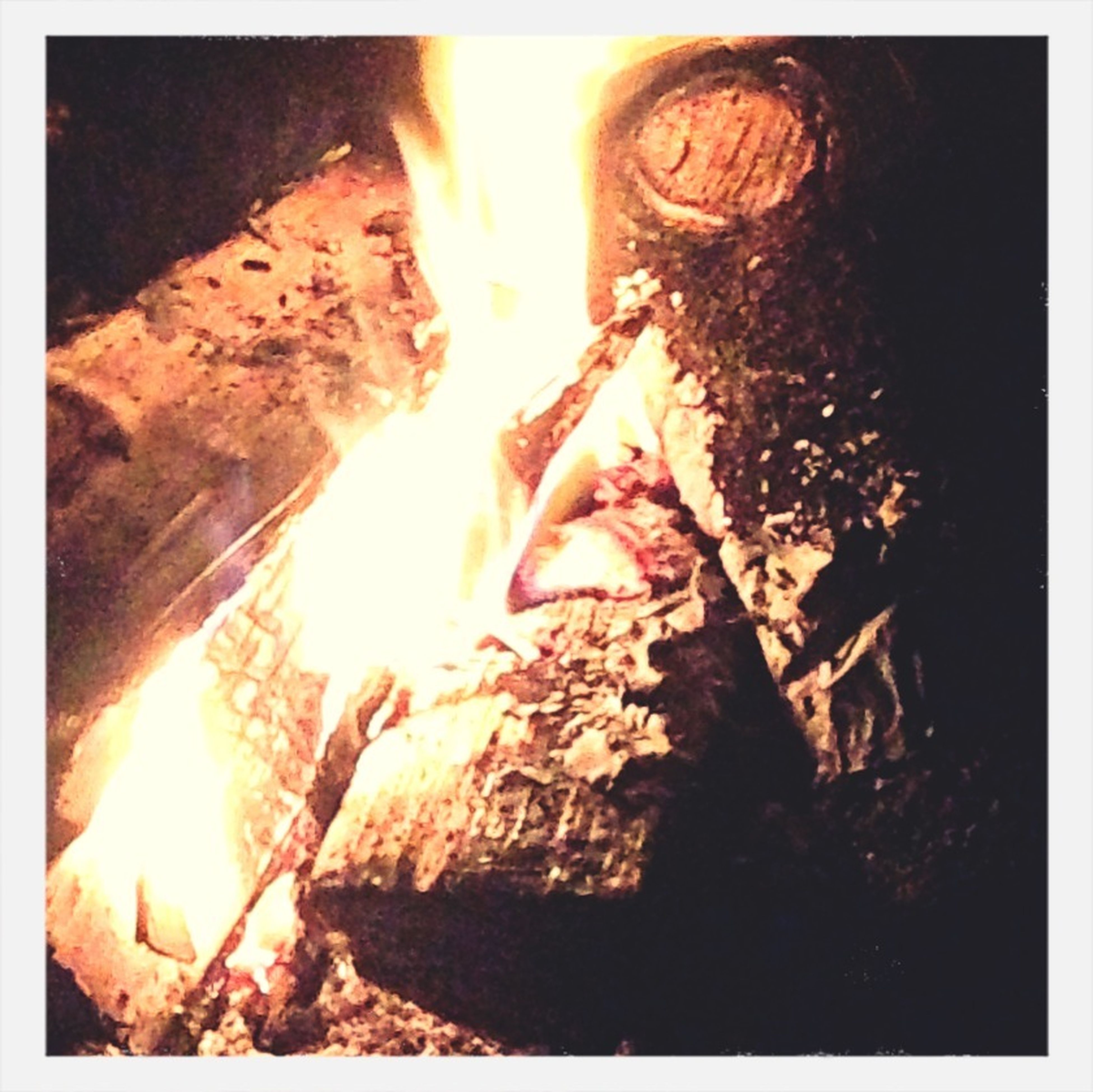 transfer print, flame, heat - temperature, burning, fire - natural phenomenon, auto post production filter, bonfire, rock - object, rock formation, firewood, heat, fire, sunlight, glowing, outdoors, motion, night, campfire, nature, no people