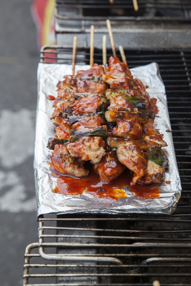 Market of Korea street food Barbecue Chicken Skewers Close-up Day Delicious Food Food And Drink Freshness Hot Human Body Part One Person Outdoors People Spicy Vertical