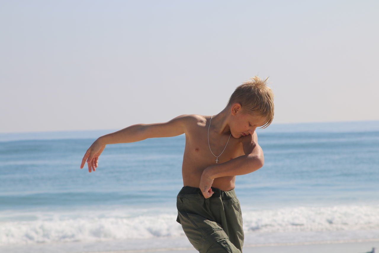 Beautiful stock photos of tanz,  8-9 Years,  Arms Outstretched,  Beach,  Beauty In Nature