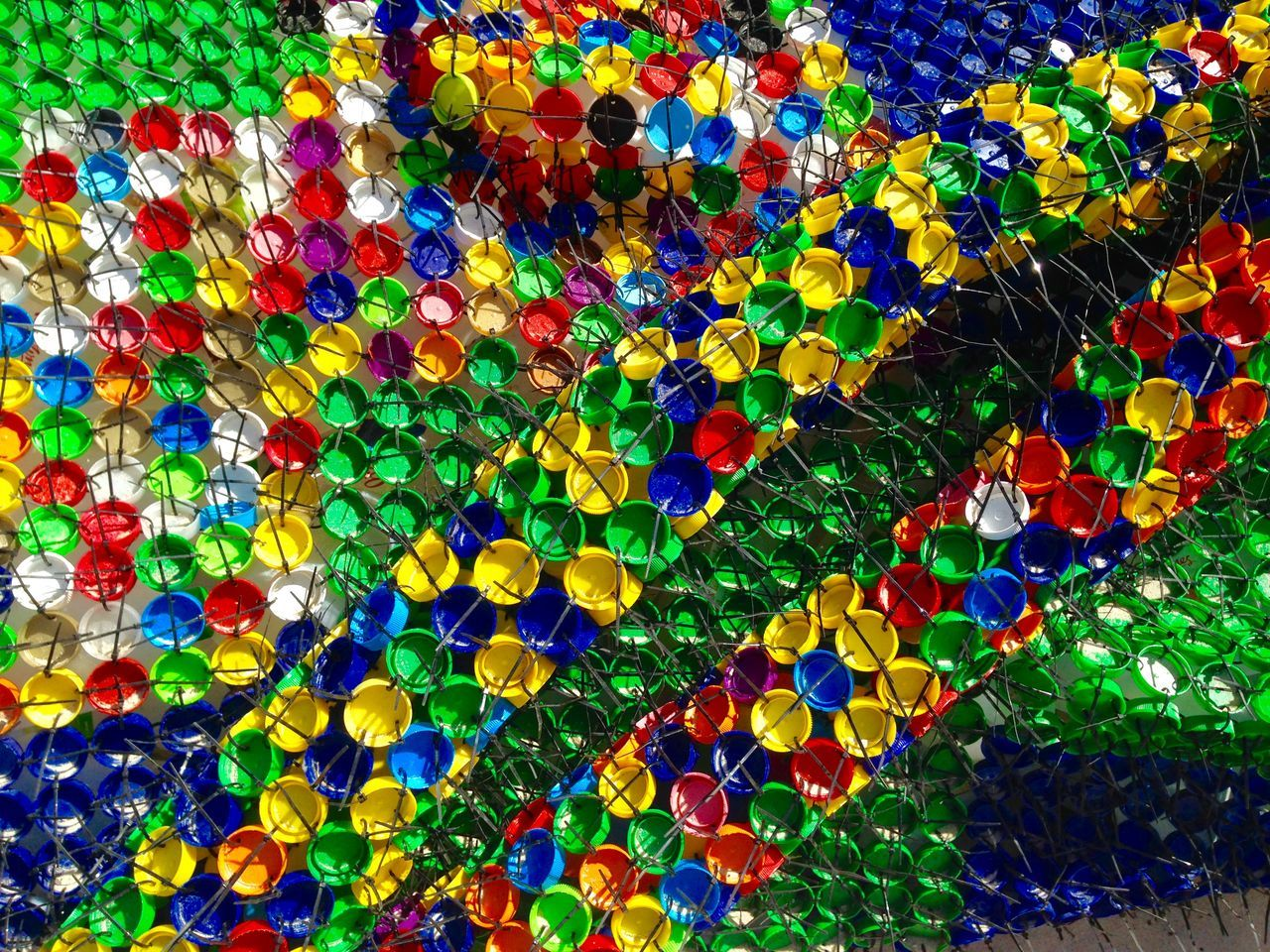 Upcycling: Sculpture Abstract Plastic Plastic Lids Milk Tops Upcycling Recycling Western Australia Sculptures By The Sea Sculpture Perth Cottesloe Beach Expressive Sculpture Sculpture Detail Recycled Art Art Abstract Primary Colors Color Circles Bottle Cap Art Milk Top Art Milk Top Sculpture Unique Sculpture