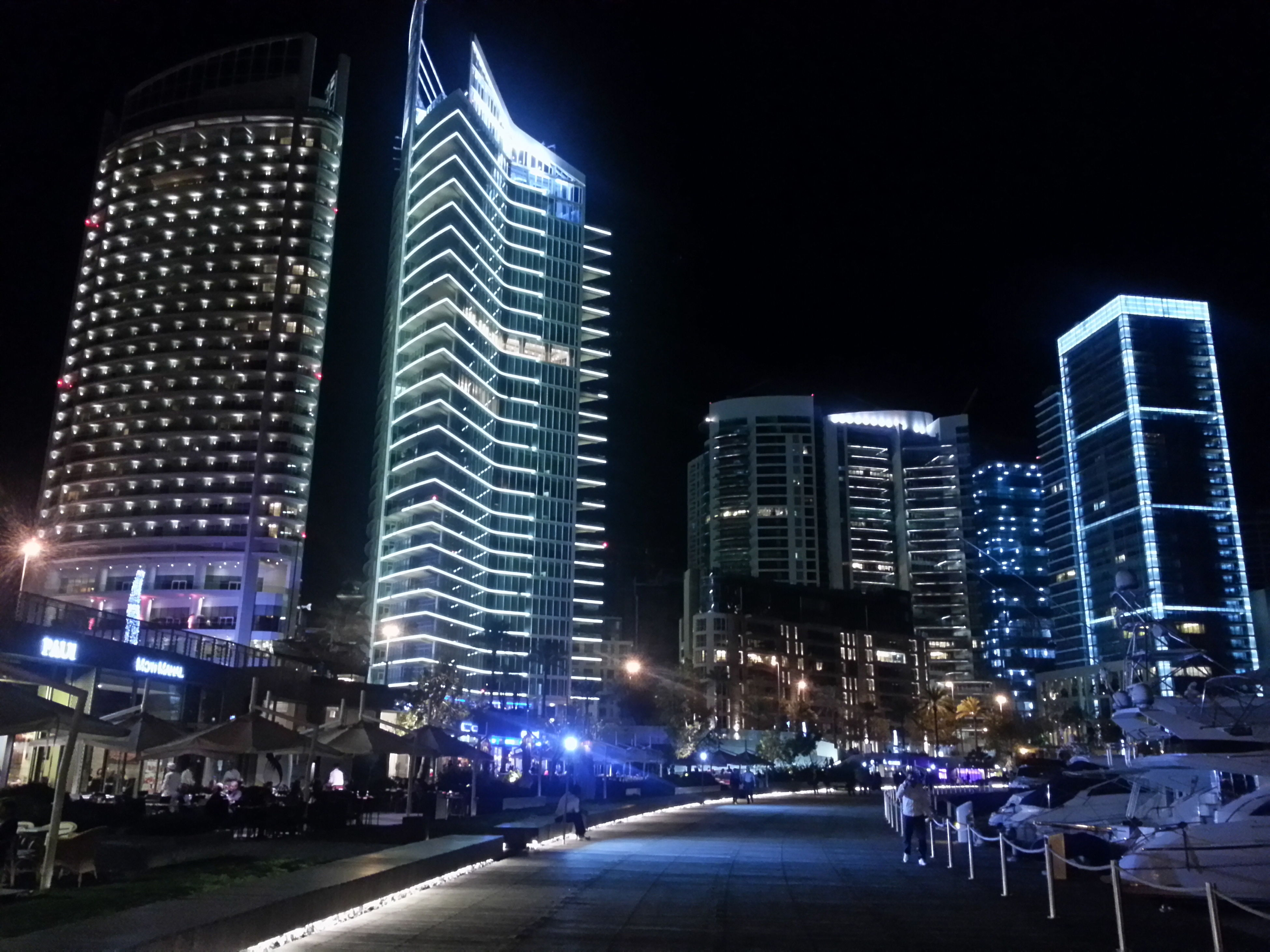 architecture, building exterior, city, built structure, illuminated, skyscraper, night, modern, tall - high, office building, tower, city life, transportation, capital cities, street, the way forward, financial district, building, cityscape, car