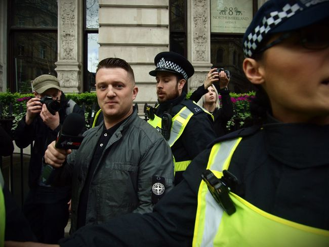 Tommy Robinson. Founder of the English Defence League, goading anti Facism protesters and being escorted away by Metropolitan police officers. London. 01-04-2017 Stevesevilempire London News Olympus English Defence League Tommy Robinson London Right Wing Steve Merrick EDL Racist Racism Zuiko Uk
