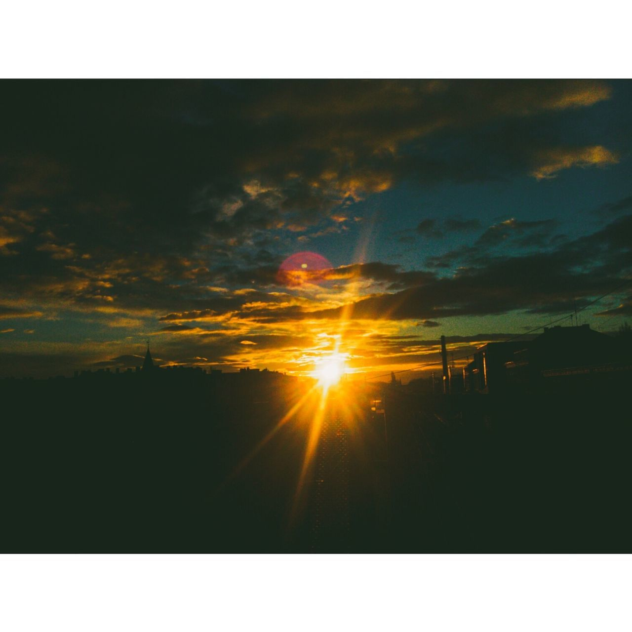 sunset, sun, silhouette, nature, scenics, tranquility, sunbeam, tranquil scene, sky, beauty in nature, no people, sunlight, outdoors, cloud - sky, landscape, day