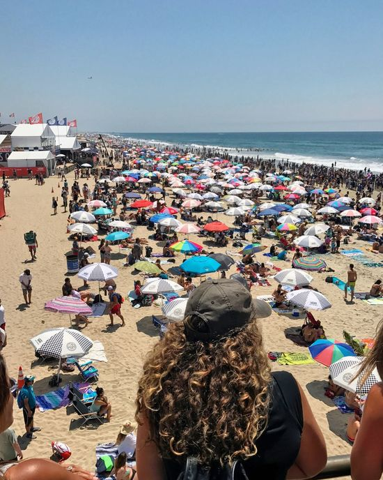 Sea Beach Water Large Group Of People Horizon Over Water Real People Rear View Clear Sky Sand Day Outdoors Leisure Activity Lifestyles Women Summer Vacations Nature Enjoyment Men Sky Vansusopen Huntington Beach