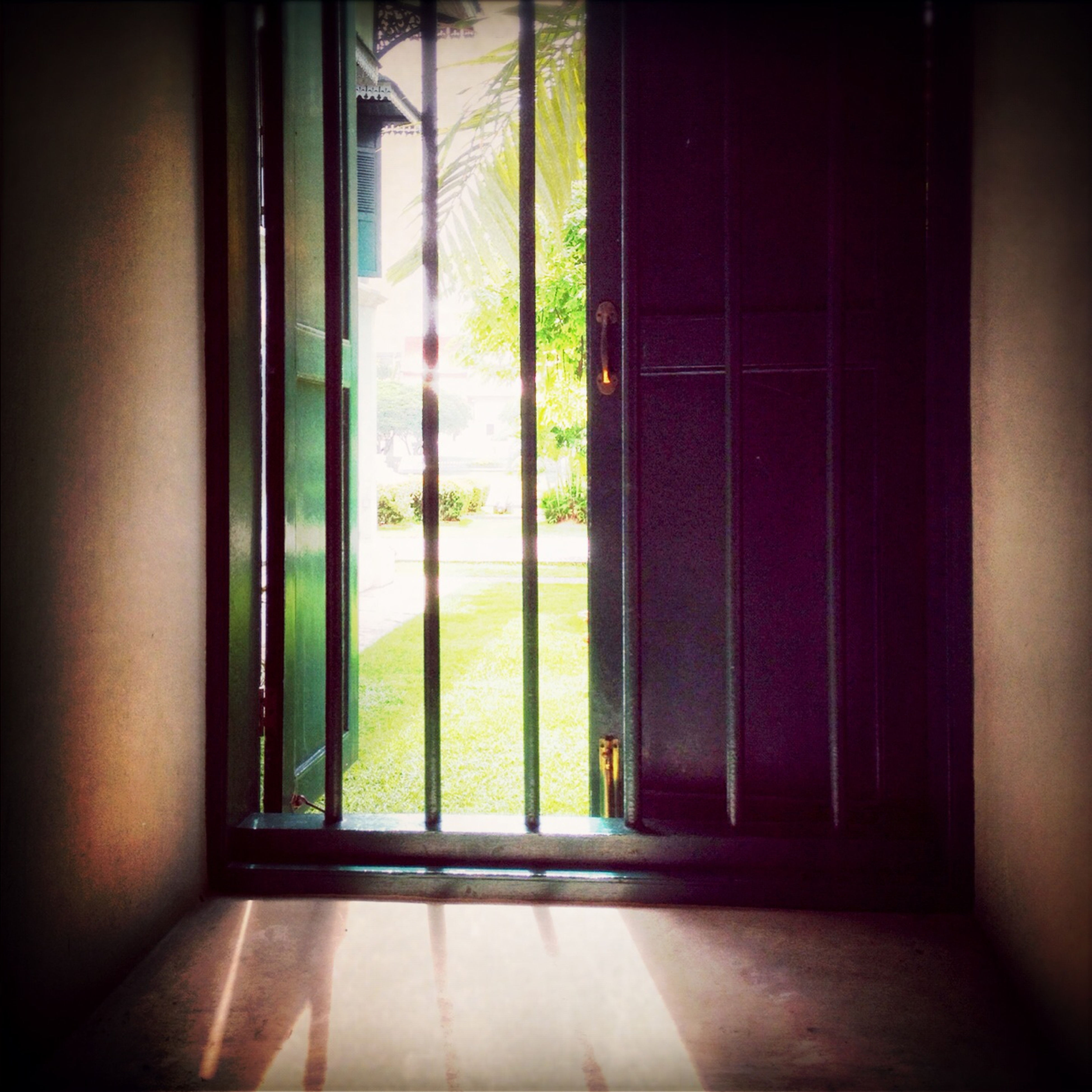 indoors, window, glass - material, transparent, door, home interior, closed, house, curtain, window sill, built structure, architecture, sunlight, domestic room, doorway, open, day, entrance, glass, window frame