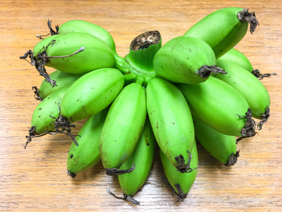 Banana Bunch Close-up Day Food Food And Drink Freshness Fruit Green Bananas Green Color Healthy Eating Large Group Of Objects No People Outdoors Wood - Material