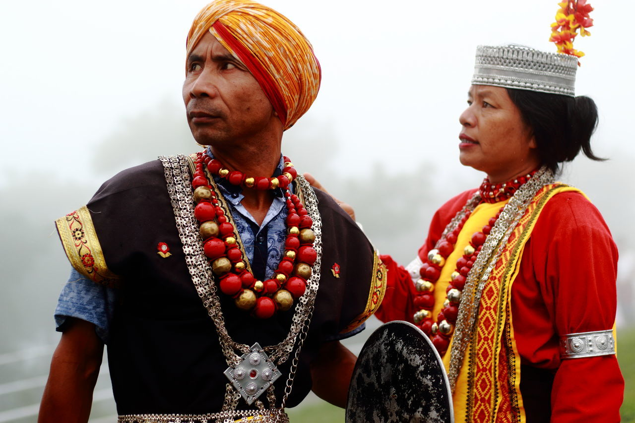 real people, traditional clothing, two people, jewelry, necklace, standing, lifestyles, young women, day, young adult, women, men, outdoors