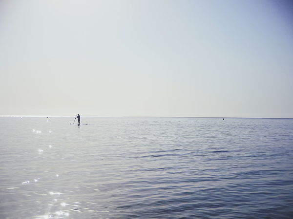 Sea Horizon Over Water Tranquil Scene Scenics Outdoors Silhouette Rippled Day Tranquility Water Beauty In Nature Waterfront One Person Sky Landscape Awe Full Length Adult People Vacations Nature