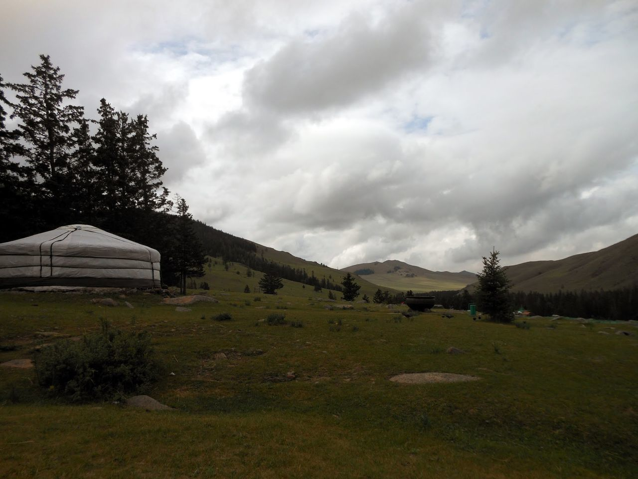 landscape, sky, tranquility, grass, nature, scenics, built structure, tranquil scene, tree, outdoors, cloud - sky, no people, field, beauty in nature, day, architecture, mountain, building exterior, scenery