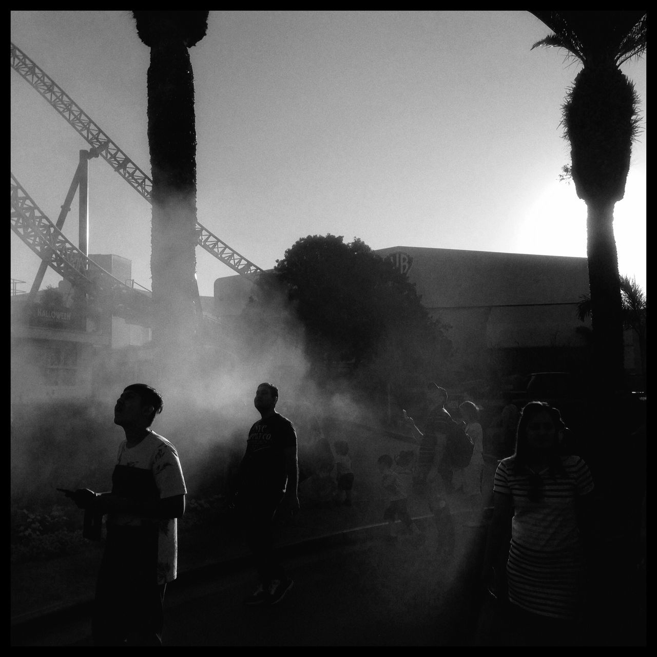 Monochrome Photography Men Smoke - Physical Structure Large Group Of People Standing Built Structure Occupation Teamwork Spraying Outdoors Streetphotography Streetphotography_bw
