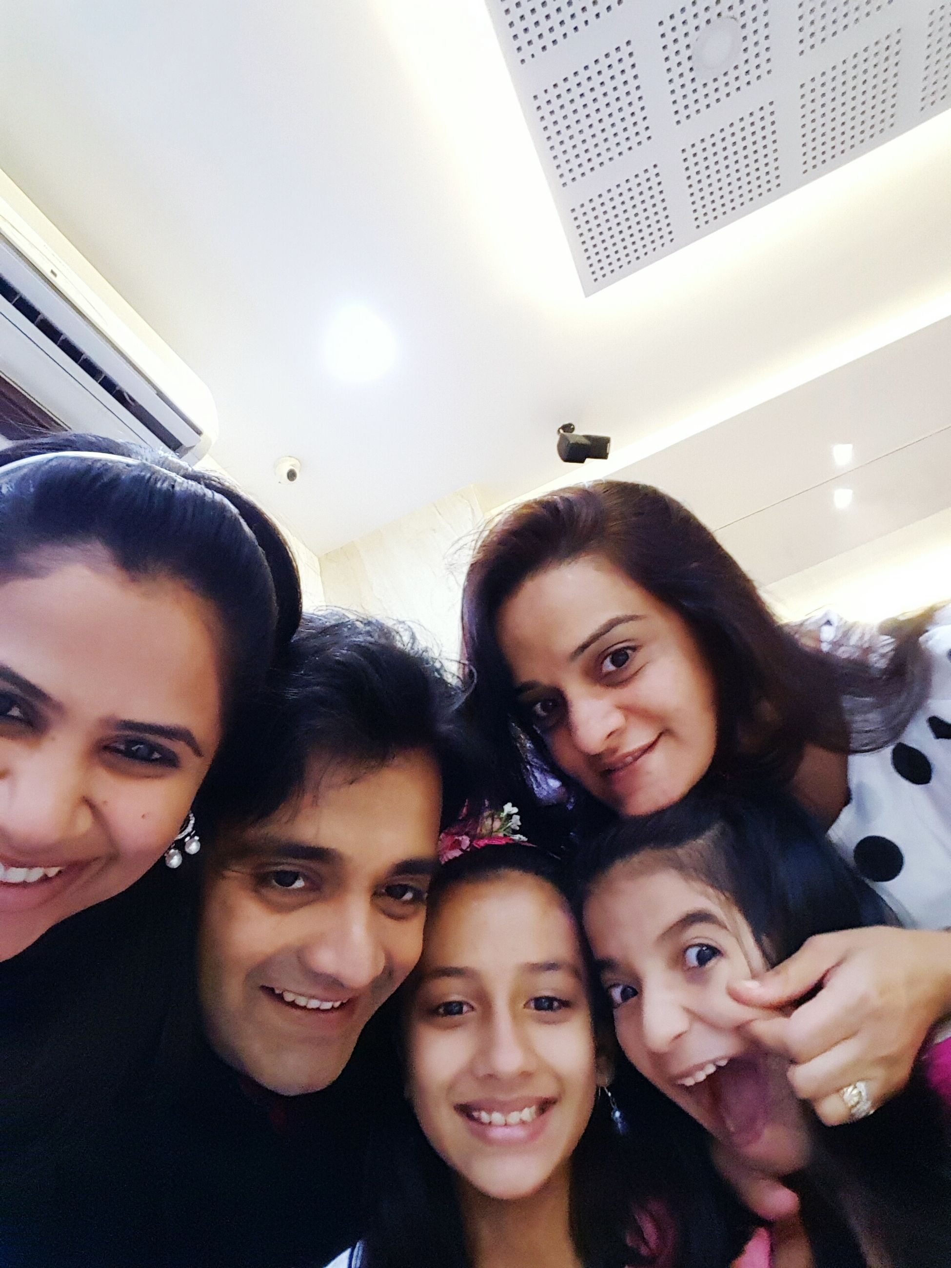 togetherness, lifestyles, leisure activity, indoors, bonding, person, happiness, enjoyment, love, fun, smiling, portrait, family, childhood, looking at camera, young women, young adult, friendship