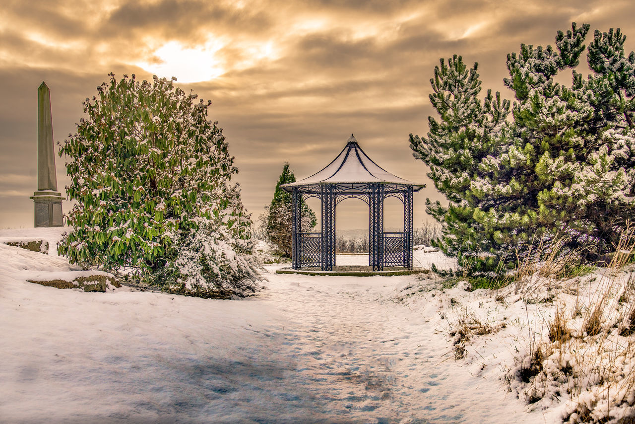 Gazebo covered in snow at a cemetery. Architecture Building Exterior Built Structure Cloud - Sky Cold Temperature Day Gazibo Landscape Nature No People Outdoors Path Sky Snow Tranquility Tree Tree Vacations Water