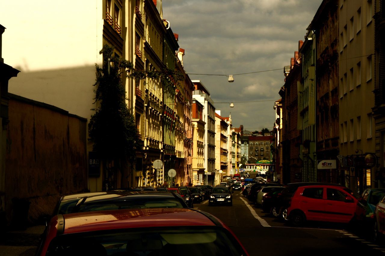 #cars #City #city Life #old Buildings #Prague #street #streetphotography #sunset #upcoming Storm #weather