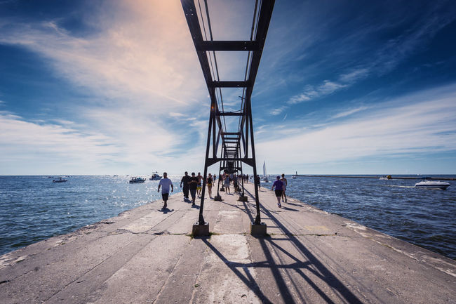 Beauty In Nature Blue Calm Cloud Cloud - Sky Day Footpath Horizon Over Water Large Group Of People Long Nature Ocean Person Pier Promenade Scenics Sea Sky Solitude The Way Forward Tourism Tranquil Scene Tranquility Water